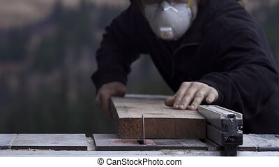 Carpenter Rips Plank of Spruce - Wearing appropriate safety...