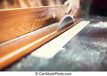Carpenter sawing wooden planks - Unrecognizable carpenter...