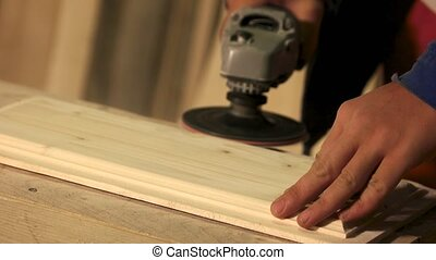 Carpenter smoothing surface of wood plank. Professional ...