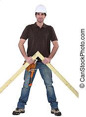 Carpenter stood with wooden truss