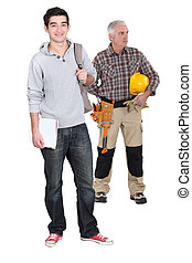 Carpenter stood with young male trainee
