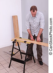 carpenter taking measurements