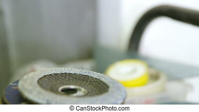 Carpenter tape and grinder blade in shop 4k - Close-up of ...