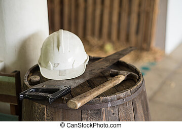 Carpenter tools at working space, focus at handel of saw