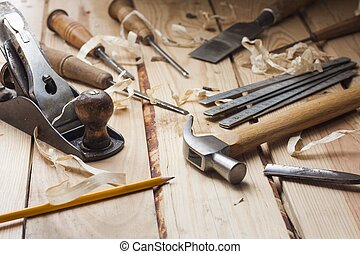 carpenter tools, hammer, meter, nails, shavings, and chisel ...