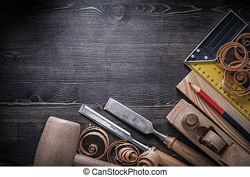 Carpenter tools on wooden board construction concept