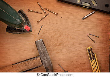 Carpenter tools on a wooden rustic background