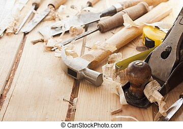 carpenter tools,hammer,meter,nails,shavings, and chisel over...