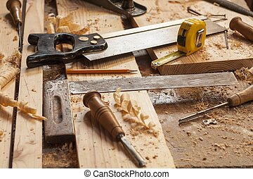 carpenter tools in pine wood table