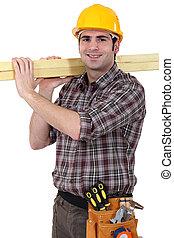 Carpenter transporting wood