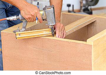 carpenter used air-gun for make ne