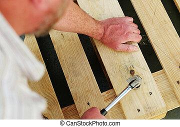 Carpenter using a claw hammer