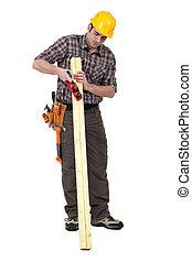 Carpenter using a tool