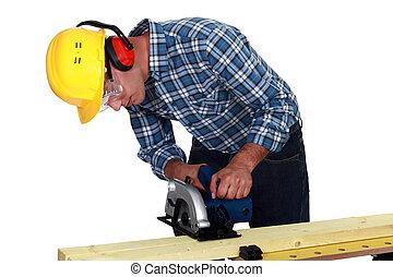 Carpenter using band saw