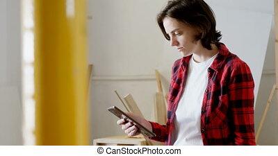 Carpenter using digital tablet in workshop 4k - Female ...