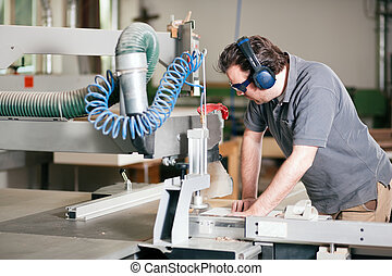 Carpenter using electric saw - Carpenter working on an...