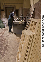 Carpenter using electric saw