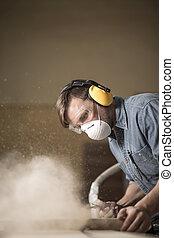 Carpenter using electric saw
