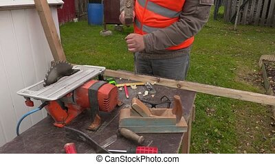 Carpenter using hammer and chisel at the working table