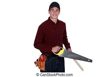 Carpenter using hand-saw