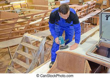 Carpenter using sander