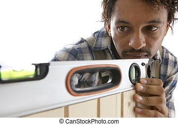 Carpenter using spirit-level