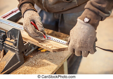 Carpenter Using Tape Measure