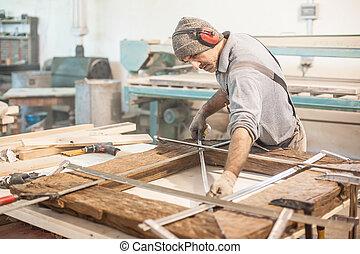 Carpenter Using Tape Measure