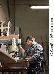 Carpenter using woodworking machine