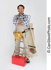 Carpenter with a toolbox and stepladder