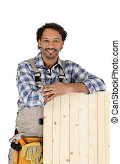 Carpenter with a wooden shutter