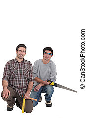 Carpenter with an apprentice