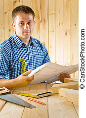 carpenter with blueprint