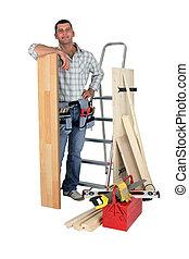 Carpenter with floorboards