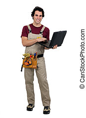 Carpenter with laptop computer