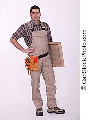 Carpenter with wooden door