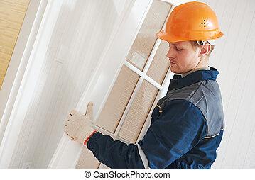 carpenter worker at door installation