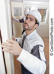 carpenter worker at door installation