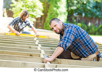 Carpenter Working At Construction Site