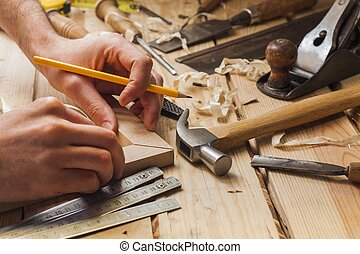 carpenter working, hammer, meter and screw-driver on ...