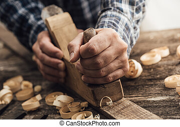 Carpenter working in his workshop