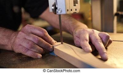 Carpenter working in workshop. Joiner labourer cuts wooden ...