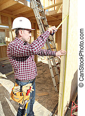 Carpenter working on house