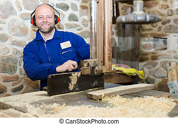 Carpenter working with a power-saw