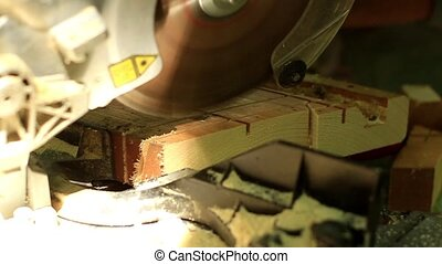 Carpenter working with Industrial tool in wood factory, circular blade with a wood board