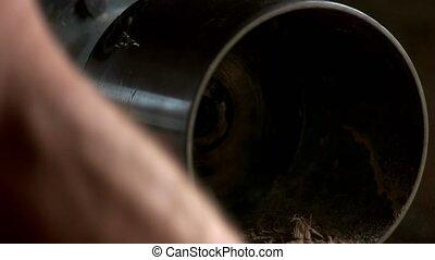 Carpenter working with metal machine.
