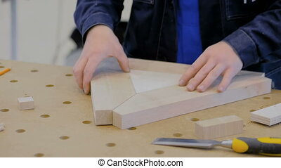 Carpenter working with wooden details - Professional man...