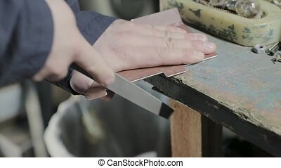 carpenter works as a file for metal video.