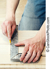carpenter works using metal angle - closeup work operation...