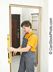 Carpenter works with level
